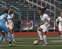Boston Aztec forward Sonia Basma (8) dribbles. In a Women's Premier Soccer League (WPSL) match, Boston Aztec (white) defeated Seacoast United Mariners (blue), 2-1, at North Reading High School Stadium on Arthur J. Kenney Athletic Field on on June 23, 2013. Due to injuries through the season, Seacoast United Mariners could only field 10 players.