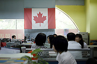 CHINA. Beijing. Inside the offices of Aoji, an organisation which assists Chinese students in language training and placing them in overseas universities throughout the world. 2010