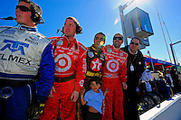 Juan Pablo Montoya, Dario Franchitti and Chip Ganassi look for their car #01 to come out of turn 4 to take the checkered flag and the win.