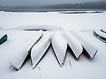 Canoes in winter snow at Eagles Mere, PA. dock.