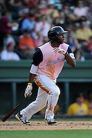 Designated hitter Kendrick Perkins (10) of the Greenville Drive bats in a game against the West Virginia Power on Sunday, May 11, 2014, at Fluor Field at the West End in Greenville, South Carolina. Greenville won, 9-6. (Tom Priddy/Four Seam Images)