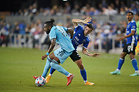 SAN JOSE, CA - AUGUST 17: Romain Metanire #19 of Minnesota United battles for the ball with Paul Marie #3 of the San Jose Earthquakes during a game between Minnesota United FC and San Jose Earthquakes at PayPal Park on August 17, 2021 in San Jose, California.