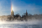 January 2, 2018; A sun dog appears over the Golden Dome. The effect is caused by ice crystals suspended in the air. (Photo by Matt Cashore/University of Notre Dame)