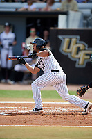 UCF Knights second baseman Matthew Mika (14) squares around to bunt during a game against the Siena Saints on February 17, 2019 at John Euliano Park in Orlando, Florida.  UCF defeated Siena 7-1.  (Mike Janes/Four Seam Images)