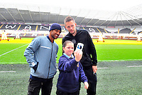 SWANSEA....<br /> WITH STORY....PREMIER LEAGUE READING STARS EVENT....<br /> THURSDAY 25th SEPTEMBER 2014<br /> Wayne Routledge signs autographs during the Premier League Reading Stars event at the Liberty Stadium.