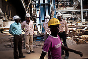 Chinese engineers from Sepco are seen with Indian workers at the construction site of the Adani Power plant of 4620 MW capacity in Mundra port industrial city of Gujarat, India. Indian power companies have handed out dozens of major contracts to Chinese firms since 2008. Adani Power Ltd have built elaborate Chinatowns to accommodate Chinese workers, complete with Chinese chefs, ping pong tables and Chinese television. Chinese companies now supply equipment for about 25% of the 80,000 megawatts in new capacity.
