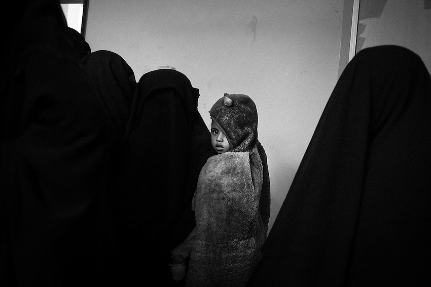 """October 10th 2012. Mothers with their children wait for attendance at a rural hospital which assists malnourished children in the impoverished district of Bayt al-Faqih, Yemen.<br /> <br /> Dr Yahya Hassan, who operates the outpatient clinic, says """"some of the malnutrition cases he has seen in recent weeks are the worst I have seen in the past 2 years of working at the centre"""".<br /> <br /> 267.000 children in Yemen are at risk of death from malnutrition already."""