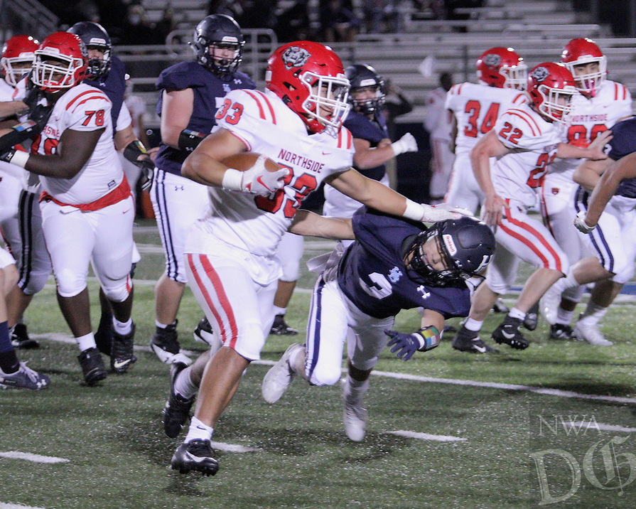 Fort Smith Northside Grizzlies Junior Ty Massey (33) stiff arms Har-Ber Wildcats Senior Liem Taylor (3) during the first round play-off game Friday, November 13, 2020, at Wildcat Stadium, Springdale, Arkansas (Special to NWA Democrat-Gazette/Brent Soule)