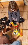 Education preschool 3-4 year olds two girls playing with toy plastic hammers and construction toy vertical