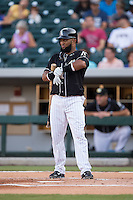 Emelio Bonifacio (8) of the Charlotte Knights at bat against the Gwinnett Braves at BB&T BallPark on August 11, 2015 in Charlotte, North Carolina.  The Knights defeated the Braves 3-2.  (Brian Westerholt/Four Seam Images)