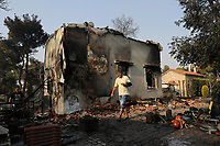 Pictured: A man inspects his burned out house in Varibobi, Athens, Greece. Wednesday 04 August 2021<br /> Re: Forest fire in Varibobi, on the outskirts of Athens, Greece.