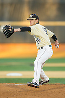 Wake Forest Demon Deacons starting pitcher Jack Fischer (15) in action against the Cincinnati Bearcats at Wake Forest Baseball Park on February 21, 2014 in Winston-Salem, North Carolina.  The Bearcats defeated the Demon Deacons 5-0.  (Brian Westerholt/Four Seam Images)