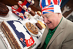 © Joel Goodman - 07973 332324 . 03/06/2012 . Manchester , UK . Councillor PAUL MURPHY of Moston Ward judges in the Queen's Diamond Jubilee cake baking competition at St Dunstan's RC church , Moston Road , Moston . Photo credit : Joel Goodman