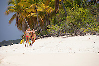 Two girls walking the shore at Sandy Cay<br /> British Virgin Islands