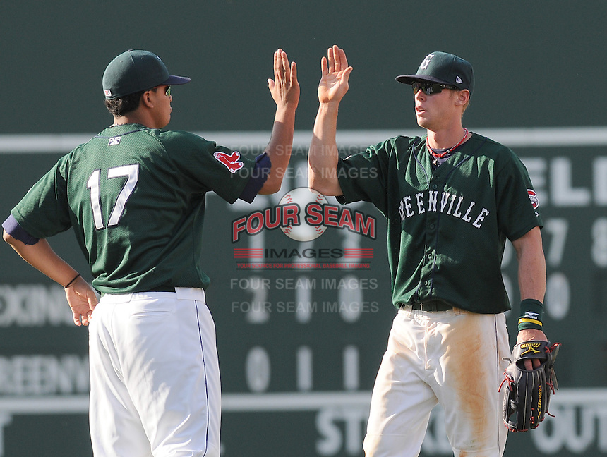 Yeiper Castillo (17) and Jeremy Hazelbaker (23) of the Greenville Drive high-five each other after beating the Lexington Legends in the first game of a doubleheader on April 25, 2010, at Fluor Field at the West End in Greenville, S.C. Photo by: Tom Priddy/Four Seam Images