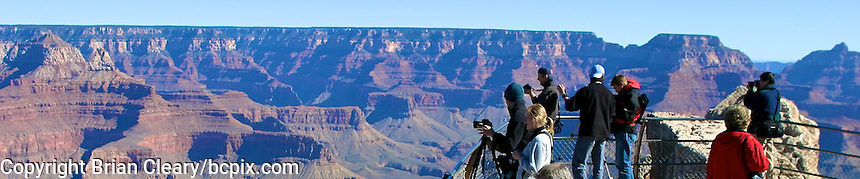 Tourists look out over the Grand Canyon, Arizona,  web banner photo, 1200x250 pixels. (Photo by Brian Cleary/ www.bcpix.com ) 1200x250 pixels and 500x100 pixels available.