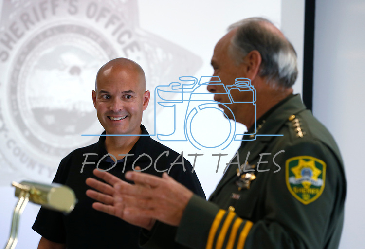 Sheriff Kenny Furlong honors retiring Capt. Brian Humphrey during a promotion ceremony at Carson City Sheriff's Office, in Carson City, Nev., on Thursday, July 2, 2020. <br /> Photo by Cathleen Allison