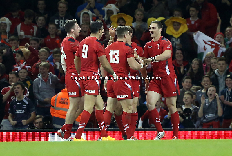 Pictured: George North of Wales (R) celerating his try with team mates. Saturday 15 November 2014<br /> Re: Dove Men Series rugby, Wales v Fiji at the Millennium Stadium, Cardiff, south Wales, UK.