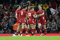 Pictured: George North of Wales (R) celerating his try with team mates. Saturday 15 November 2014<br />