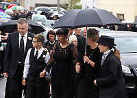 """COPY BY TOM BEDFORD<br /> Pictured: Gemma Black, Pearl's mum (C) joined by family and friends arrives at the Jerusalem Baptist Chapel in Merthyr Tydfil, Wales, UK. Friday 18 August 2017<br /> Re: The funeral of a toddler who died after a parked Range Rover's brakes failed and it hit a garden wall which fell on top of her will be held today at Jerusalem Baptist Chapel in Merthyr Tydfil.<br /> One year old Pearl Melody Black and her eight-month-old brother were taken to hospital after the incident in south Wales.<br /> Pearl's family, father Paul who is The Voice contestant and mum Gemma have said she was """"as bright as the stars""""."""