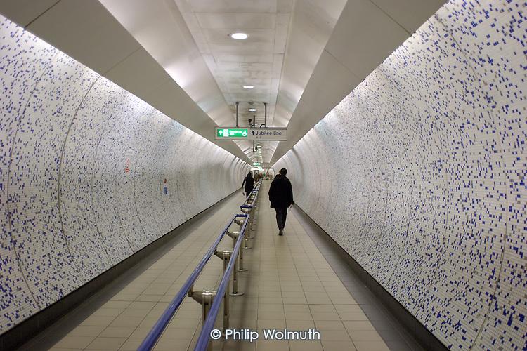 A pedestrian walkway in Green Park underground station, London.
