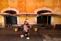 Two people wearing masks to protect themselves from the Covid-19 walk past a closed cafe in Rome, Italy, March 10, 2020. The Italian government imposed restriction aimed to contain the Covid-19 spread, including cafes, restaurants and other shops forced to close at 6pm and forbidding personal movement.<br /> UPDATE IMAGES PRESS/Riccardo De Luca