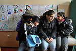 Girls talk among themselves in the Branko Pesic School, an educational center for Roma children and families in Belgrade, Serbia, which is supported by Church World Service. Many of the students' families came to Belgrade as refugees from Kosovo. Many of them lack legal status in Serbia, and thus have difficulty obtaining formal employment and accessing government services.