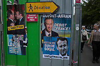 """France. Ile de France. Paris. Partially torn campaign posters of French presidential election candidates<br /> Emmanuel Macron for the centrist party """"En Marche"""" and Nicolas Dupont-Aignan for the right-wing party """" Debout la France"""". Posters on a construction site. 22.04.17 © 2017 Didier Ruef"""