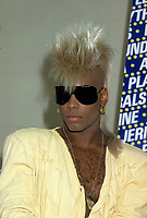 "1986 file photo - Montreal, Quebec, CANADA - <br /> Fomer Plasmatics Jean Beauvoir during a press conference<br /> <br /> Born of Haitian parents in Chicago, Illinois, Jean was destined to be a performer. He was the leader of the junior high school rock band at 13, which lead to playing dances and clubs throughout the New York area. Lying about his age, that summer he was recruited to be musical director for Gary US Bonds and went on to do shows throughout the US with Dick Clark, Bo Diddley, Chuck Berry and many others. Soon after this, he became the youngest lead singer of the group The Flamingos of I Only Have Eyes for You fame.<br /> <br /> Having difficulty at home with his choice of profession, he moved out on his own and headed to the Big Apple at the tender age of 15. Before long, he found himself in contact with the New York punk scene. After seeing an ad in a local newspaper, he was recruited for what was the beginning of the group NThe Plasmatics"". He changed his image to suit the part: the awakening of the blond mohawk.<br /> <br /> The Plasmatics went on to take over the US and worldwide press within six months of his entry to the gang. Wendy OOWilliams and the bandOs exorbitant stage antics shocked millions and made them a household name as a highlight of the 6 oOclock news and Saturday morning cartoons. After three years of constant touring and recording, Jean decided it was time for him to move on. Little Steven was coincidentally introduced to Beauvoir by Gay U.S. Bonds manager. Recognizing his talent, Steven convinced him to participate on the Little Steven & Disciple of Soul albums Men without Women and Voice of America. This was the beginning of a long friendship and working relationship. These critically acclaimed albums and two years of worldwide touring gave Jean the credibility that he needed to be accepted as an artist of his own rank. He soon partnered up with Gary Kurfirst and Richard Branson and signed his first co-venture label deal with Virgin Records with JeanOs solo album sl"