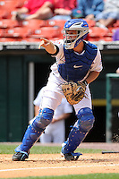 Buffalo Bisons catcher Josh Thole, on rehab assignment from the NY Mets, calls out where to throw the ball as Michel Hernandez #49 slides in safely during a game against the Columbus Clippers at Coca-Cola Field on May 31, 2012 in Buffalo, New York.  Columbus defeated Buffalo 3-0.  (Mike Janes/Four Seam Images)
