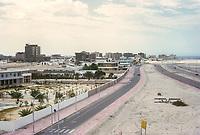 Abu Dhabi, UAE.  Corniche Street Scene.  Abu Dhabi begins its modern development. Persian (Arabian) Gulf in distance on right.  Photographed March 1972.