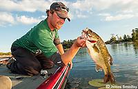 Man hoisting largemouth bass