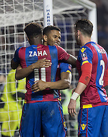 Goal scorer Fraizer Campbell (centre) of Crystal Palace with Wilfried Zaha of Crystal Palace & Joel Ward of Crystal Palace after scoring the second goal during the FA Cup quarter-final match between Reading and Crystal Palace at the Madejski Stadium, Reading, England on 11 March 2016. Photo by Andy Rowland/PRiME Media Images.