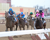 Coma to the Top, rail, and Saturday's Charm battle to the wire in the Tom Fool.