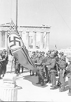 Pictured: German soldiers by a swastika in Acropolis, 1941. STOCK PICTURE<br /> Re: Manolis Glezos, who took down a flag with a swastika from the Acropolis 30th of May 1941.