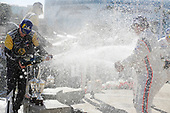 #5 Mustang Sampling Racing Cadillac DPi, DPi: Joao Barbosa, Filipe Albuquerque, #6 Acura Team Penske Acura DPi, DPi: Juan Pablo Montoya, Dane Cameron, #7 Acura Team Penske Acura DPi, DPi: Helio Castroneves, Ricky Taylor celebrate on the podium with champagne