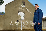 Artist Mike O'Donnell who is painting the Mikey Sheehy Mural.