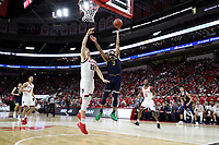 RALEIGH, NC - JANUARY 9: Prentiss Hubb #3 of the University of Notre Dame shoots a layup over Danny Dixon #21 of North Carolina State University during a game between Notre Dame and NC State at PNC Arena on January 9, 2020 in Raleigh, North Carolina.