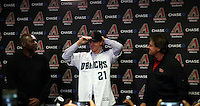 Zack Greinke is introduced to the media at a press conference held after the Arizona Diamondbacks signed the right-handed pitcher as a free agent. Greinke is surrounded by general manager Dave Stewart (L) and director of baeball operations Tony LaRussa (R). The event was held at Chase Field on December 11, 2015 in Phoenix, Arizona (Bill Mitchell)