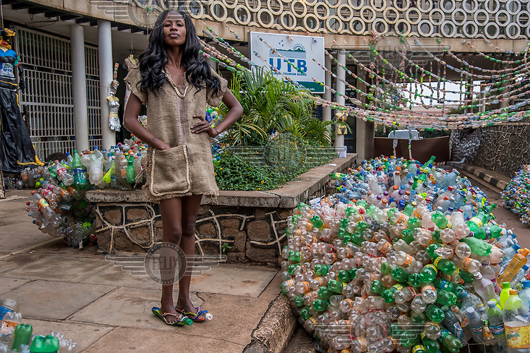 A model at the Trash on Fashion Show, part of the Bayimba cultural festival at the Kampala National Theatre, wearing clothes made from a hessian sack created by the Afrika Arts Kollective, which specialises in waste recovery and recycling. Their goal is to make the public aware of the possibilities of economy and ecology which conceal everyday life and its waste.