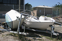 Miami Beach, FL 10-25-2005.Wrecked and sunk boats litter the landscape.around the Miami Yacht Club located on.Watson Island in Miami Beach.Digital Photo by Adam .