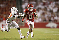 Arkansas running back AJ Green (0) carries the ball, Saturday, September 11, 2021 during the fourth quarter of a football game at Reynolds Razorback Stadium in Fayetteville. Check out nwaonline.com/210912Daily/ for today's photo gallery. <br /> (NWA Democrat-Gazette/Charlie Kaijo)