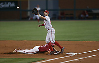 Arkansas Cayden Wallace (7) slides to first as Nebraska infielder Jack Steil (11) attempts to force the out, Saturday, June 5, 2021 during the first inning in the second game of the NCAA Fayetteville Regional at Baum-Walker Stadium in Fayetteville. Check out nwaonline.com/210606Daily/ for today's photo gallery. <br /> (NWA Democrat-Gazette/Charlie Kaijo)