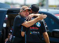Jun 10, 2017; Englishtown , NJ, USA; NHRA top fuel driver Scott Palmer hugs a crew member during qualifying for the Summernationals at Old Bridge Township Raceway Park. Mandatory Credit: Mark J. Rebilas-USA TODAY Sports