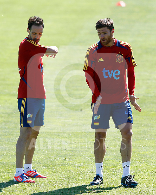 Spanish national football team Juanfran Torres (l) and Xabi Alonso during training session.May 22,2012.(ALTERPHOTOS/Acero)