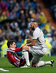 Karim Benzema (r) of Real Madrid helps Xabier Etxeita Gorritxategi of Athletic Club during their La Liga match between Real Madrid and Athletic Club at the Santiago Bernabeu Stadium on 23 October 2016 in Madrid, Spain. Photo by Diego Gonzalez Souto / Power Sport Images