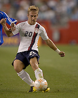 Second half substitute Taylor Twellman (United States, white shirt) shoots. The United States defeated El Salvador, 4-0, in the first round of the CONCACAF Gold Cup, in Gillette Stadium, Tuesday, June 12, 2007.