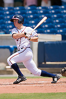 Todd Cunningham #2 of the Rome Braves follows through on his swing against the Greenville Drive at State Mutual Stadium July 25, 2010, in Rome, Georgia.  Photo by Brian Westerholt / Four Seam Images
