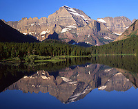 Mount Gould, 9,553 feet, reflects in calm Swiftcurrent Lake, Glacier National Park, Montana.
