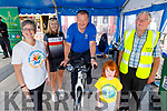 John Murray (Tralee Chain Gang) on the bike at the Celebrate4Life Stationary Bike-athon fundraiser in Tralee on Friday.  L to r: Breda Dyland (Kerry Cancer Support), Avril Hewitt, John Murray (Tralee Chain Gang on the bike), Aoife McSweeney and Dermot Crowley (Recovery Haven)